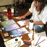 Tina in her studio working with Laura on a collaborative art piece